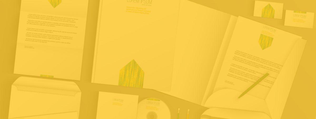 Corporate Design auf Schreibtisch Umbrellaz Design Agentur gelb gefärbt
